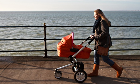 Woman pushing pram