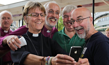 Church of England Clerics take a selfie as they celebrate after the vote to allow female bishops