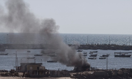 Smoke rise from a structure in the port of Gaza City where five young boys were killed by an Israeli naval bombardment.
