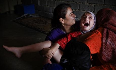 A woman cuts seven-year-old Sheelan Anwar Omer's genitals in Kurdistan.