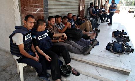 Al-Jazeera journalists evacuate their building in Gaza