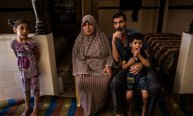 Mohamed Bakr and his wife, Sahar, with their children. The family lost one of their sons during the air strike on Gaza City's beach