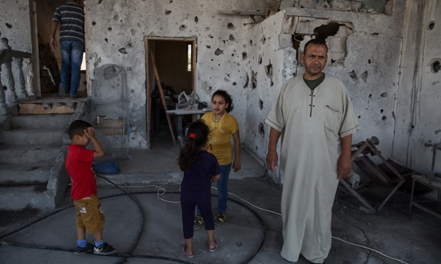 A Rafah family return to their home, which was hit by an Israeli air strike