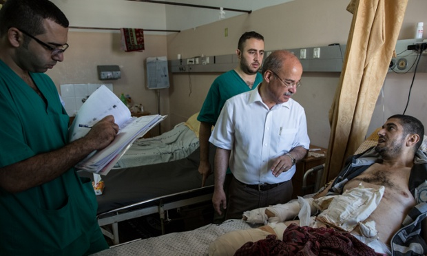 Dr Subhi Skeik medical director of Gaza.Shifa hospital checks the wounded.