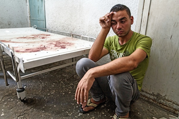 A relative outside the morgue where Taysir al-Hom and the other victims were taken, after being killed by the explosion.