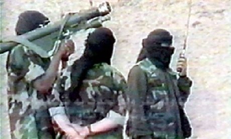 File photograph of militants training in Afghanistan in 2001 with a Russian-made anti-aircraft missile.