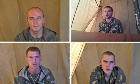 Four Russian servicemen are seen in a video released by the Ukrainian Security Service