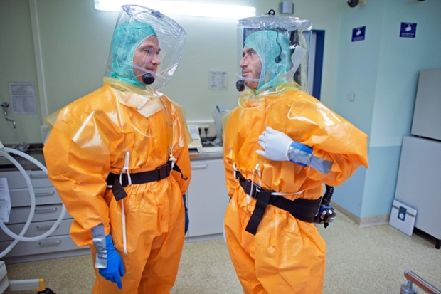Doctors communicate using headsets under their ventilated plastic suits at the Frankfurt Main university hospital in Germany, during a simulation exercise for a possible Ebola infection, or other highly contagious illnesses.