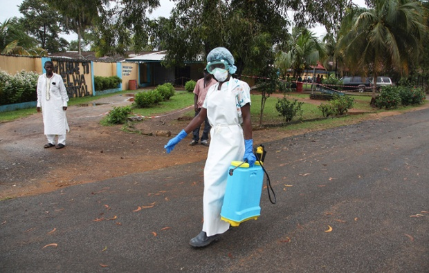 A nurse with a spray disinfectant at the ELWA Hospital where a US doctor Kent Bradley contracted the Ebola virus in Monrovia, Liberia.