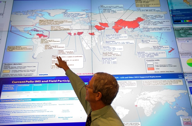 Steve Monroe, deputy director of the National Center for Emerging and Zoonotic Infectious Diseases points at a map in the Emergency Operations Center in Atlanta.