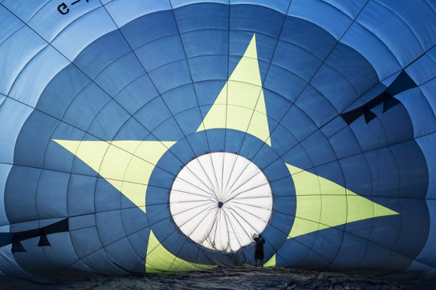 A balloonist prepares his hot air balloon at the Bristol international balloon fiesta