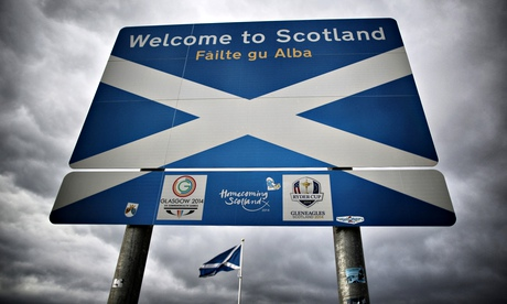 A Scottish Saltire flag flies on the border with England