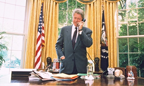 Bill Clinton standing at his desk