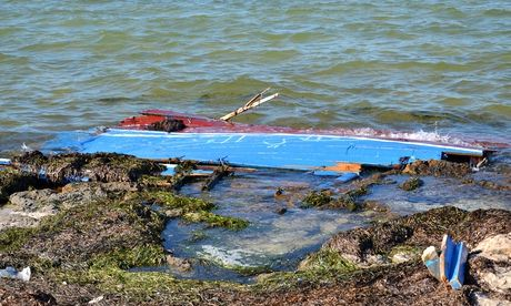 A picture taken on 29 August 2014 shows what remains of a boat carrying migrants from Libya that san
