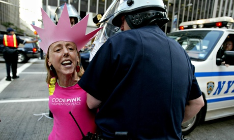 Medea Benjamin, co-founder of the activist group Code Pink, is arrested as she begins to stage a pro