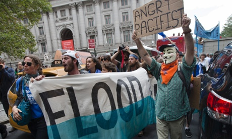 Demonstrators march towards Wall Street from Battery Park to protest for action on climate change in New York.