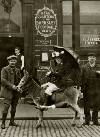 Amos the donkey, Barnsley Football Club's official mascot is pictured with his jockey outside the team's headquarters at The Clarence Hotel in Barnsley prior to their appearance in the 1910 FA Cup Final against Newcastle United. The game finished 1-1 but Newcastle triumphed 2-0 in the replay at Goodison Park.