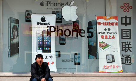 Apple iPhones advertised at a mobile phone shop in Beijing