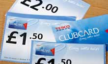 A Tesco clubcard and vouchers