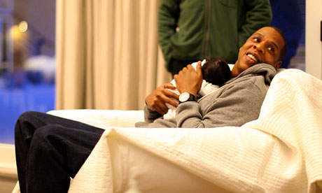 Jay-Z holds Blue Ivy, his daughter with Beyoncé