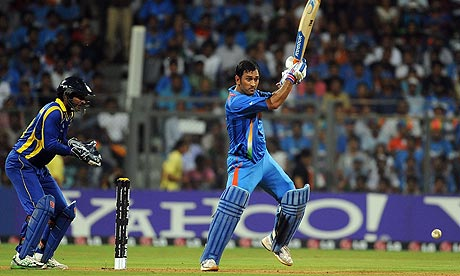 India captain Mahendra Dhoni plays a shot during the Cricket World Cup final against Sri Lanka