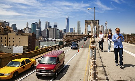 Crossing the Brooklyn Bridge, New York