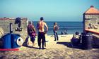 Beach wall with surfers, Malibu, California