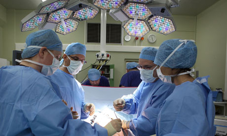 surgeon hospital pay