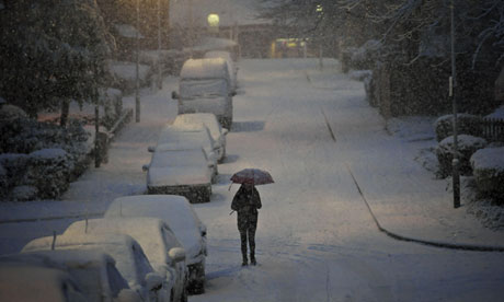 A woman walks through the snow in Bristol