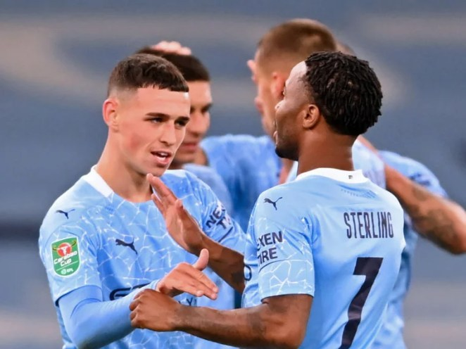 Phil Foden celebrates with teammates after scoring