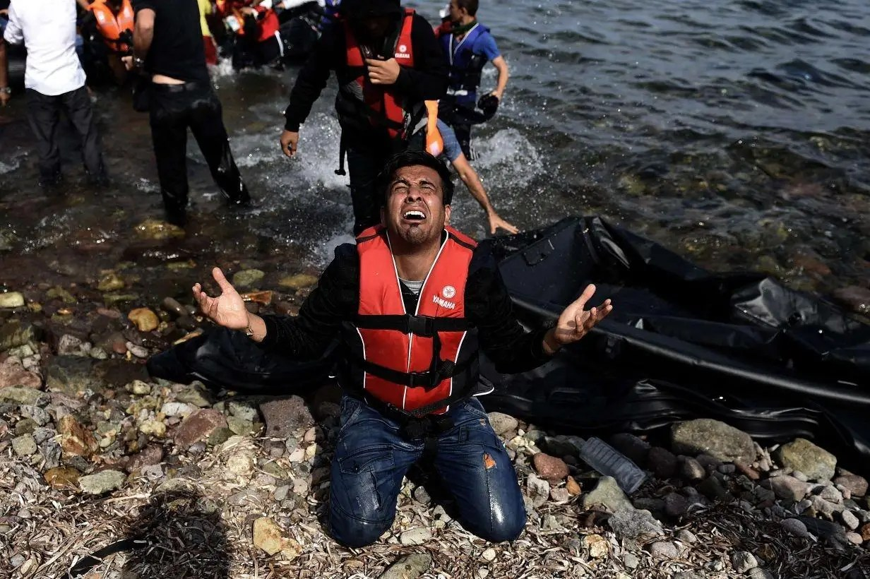 A refugee arrives at the Greek island of Lesbos