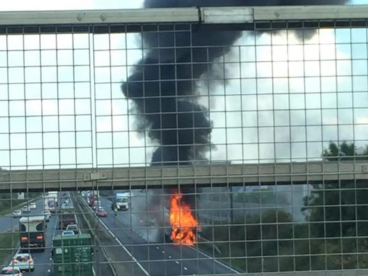 Passers-by photographed the fire from a bridge over the A14 Jasmine White/TWitter