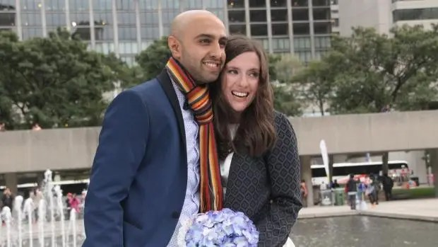 Samantha Jackson and Farzin Yousef had a smaller wedding at Toronto City Hall. Photo: Jim Martin