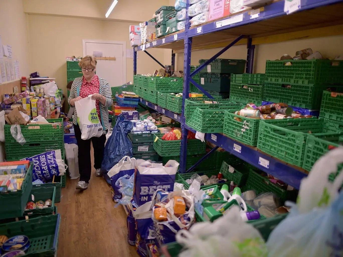 Volunteer Sandra Black packs food at the Trussell Trust Constitution Street food bank