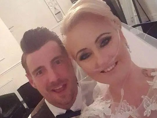 Marie Piles and her husband Sean on their wedding day