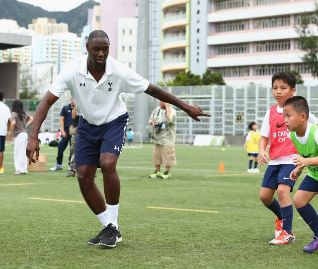 King Kong Ledley King Coaches Children In Hong Kong With The Premier Skills And Creating