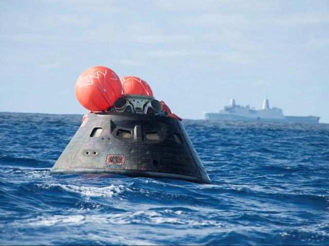 Orion Capsule splashes down