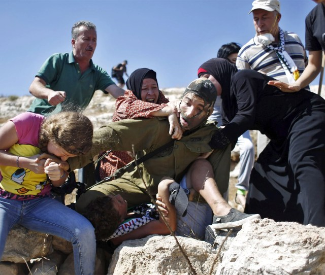The Young Girl Can Be Seen Biting The Israeli Soldiers Hand