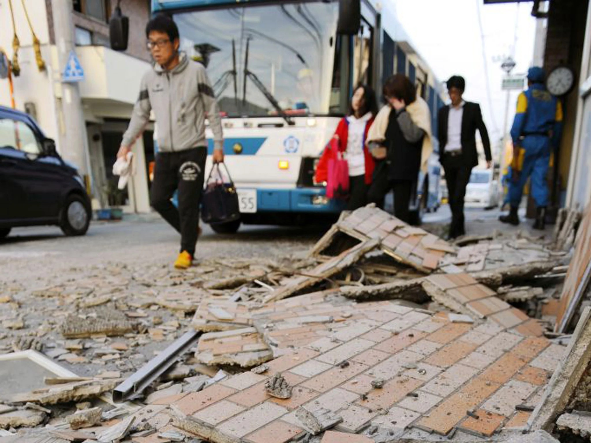 Japan Earthquakes Survivor Describes Dramatic Escape From Seventh Floor Of Damaged Building