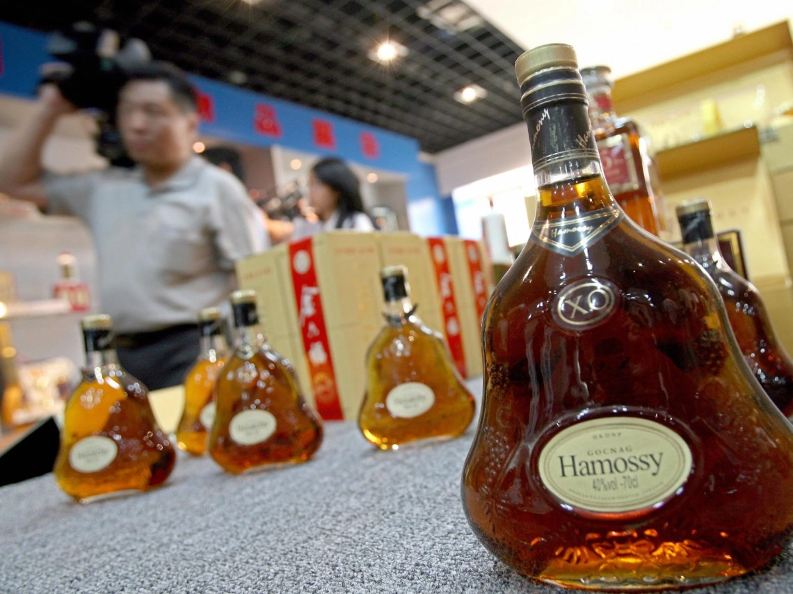 Visitors Walk Past Counterfeit Liquor On Display At The Beijing Administration For Industry And Commerce Center