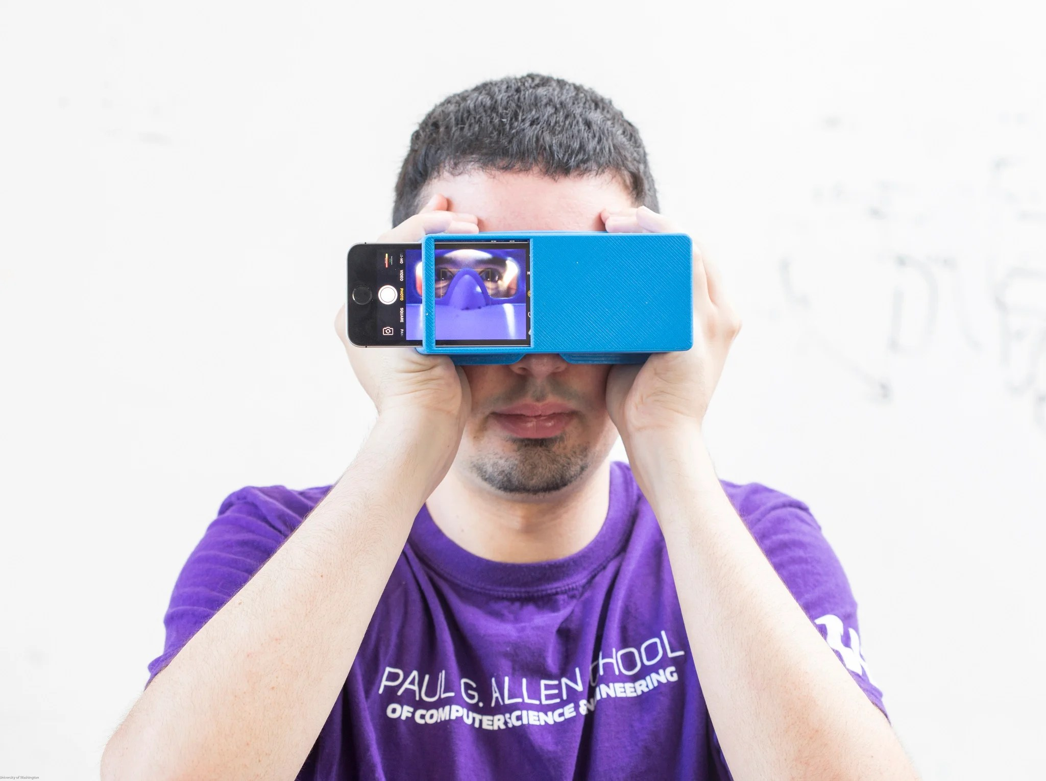 Users, wearing specially designed paper glasses or holding a 3D-printed box, take a selfie using their smartphone