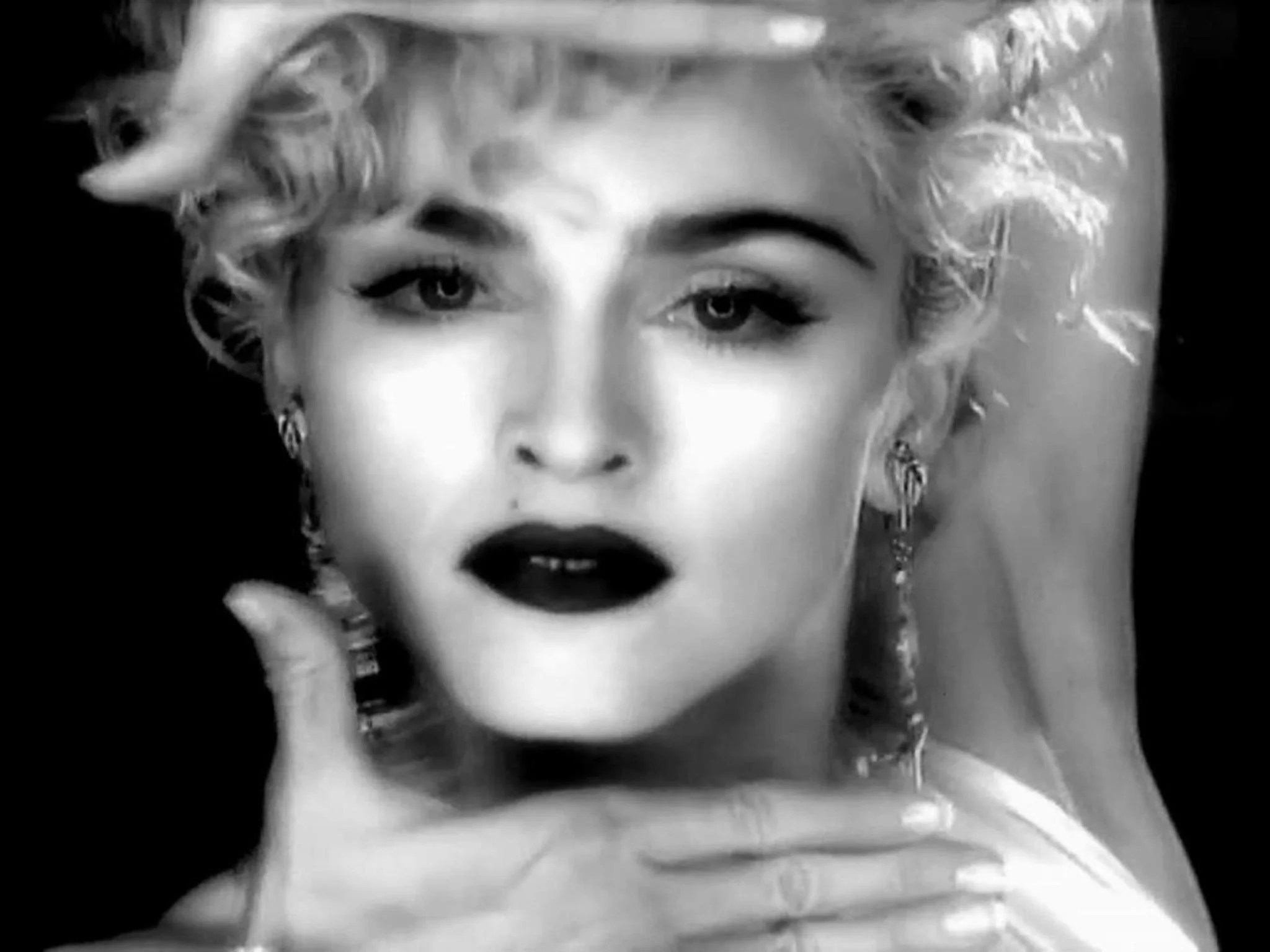 Madonna strikes a pose in her 1990 video for 'Vogue'
