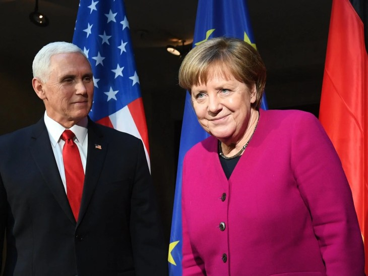Mike Pence and Angela Merkel pose at the conference on Saturday
