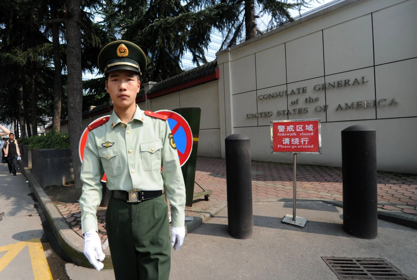 File: a Chinese paramilitary policeman stands guard at the entrance of the US consulate in Chengdu. China says it has revoked the licence for the consulate in retaliation for the closure of China's Houston consulate earlier this week