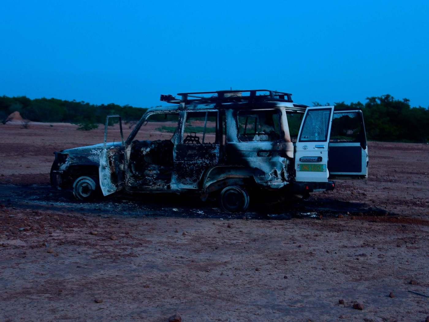 The wreckage of the car where six French aid workers, their local guide and the driver were killed by unidentified gunmen riding motorcycles in an area of southwestern Niger