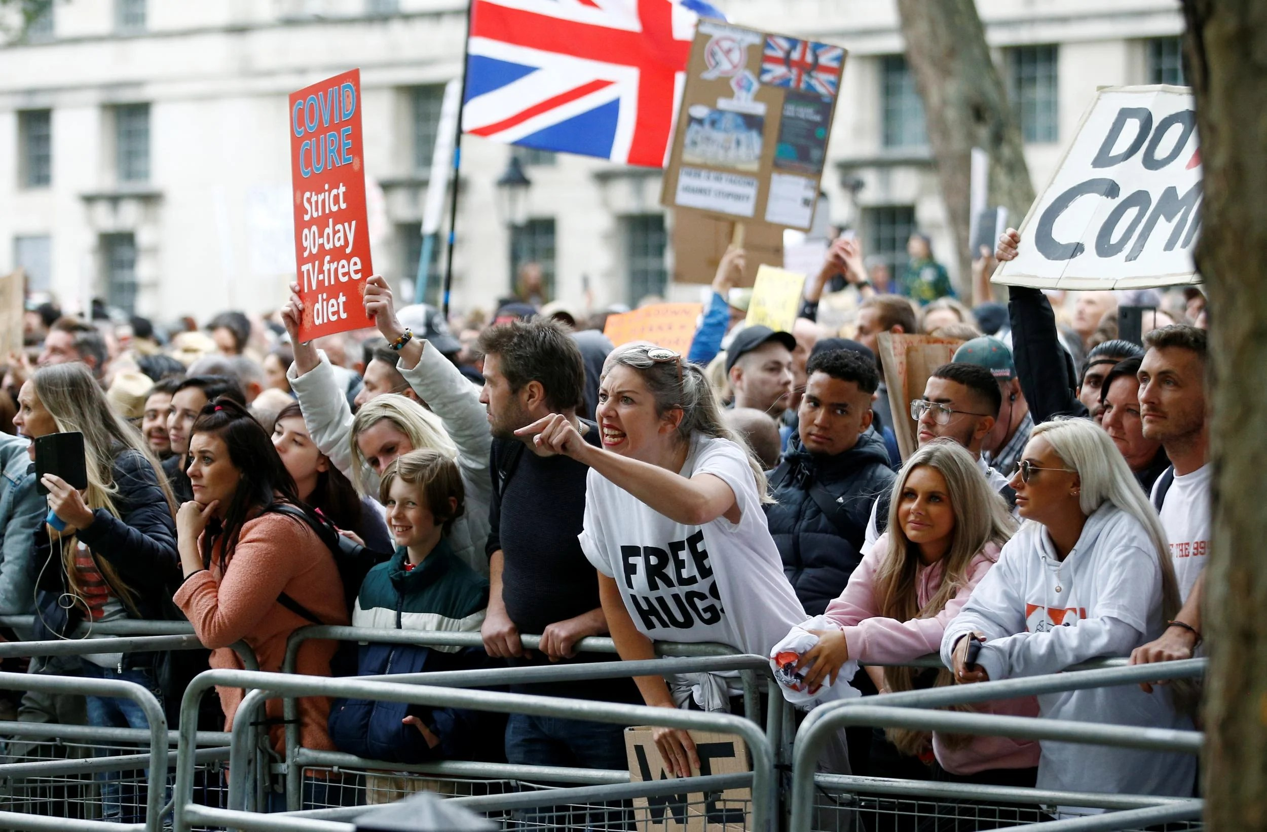 A protester reacts as she demonstrates against the lockdown and use of face masks, amid the coronavirus disease outbreak, outside Downing Street in London