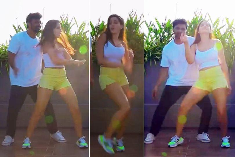 Nora Fatehi Looks Smoking Hot as She Dances in Green Shorts, White Top