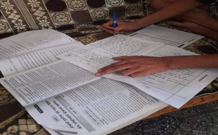 Photos of Students Writing Exam with Guide Books Goes Viral, Answers Posted on YouTube Channels