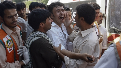 Relatives weep after a bomb attack in Peshawar on Friday.