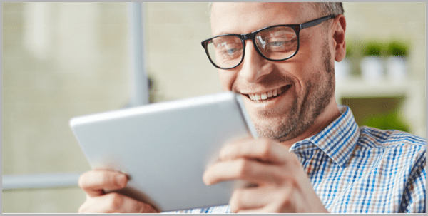 Man looking at ipad for content that converts